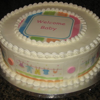 Welcome Baby Edible images made using the invitations. Simple buttercream with edible images.