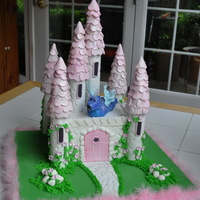Pink Castle Cake   Buttercream on the cake, fondant/gumpaste decor