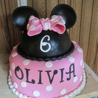 Minnie Mouse Cake   Inspired by many of the Minnie Mouse cakes on this site! Thank you! Fondant accents, and covered in fondant, ears are fondant.