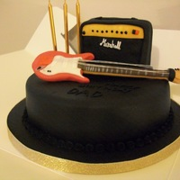 Guitar/ Amp marshall amp is made out of cake, guitar is just modelling paste, madera cake.