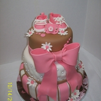 Baby Girl Shower Strawberry cake with SMB icing covered with fondant. booties, pacificer, daisys and bow made from gumpaste/fondant mix. Client gave me a...