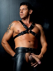 Muscle man in leather pants.